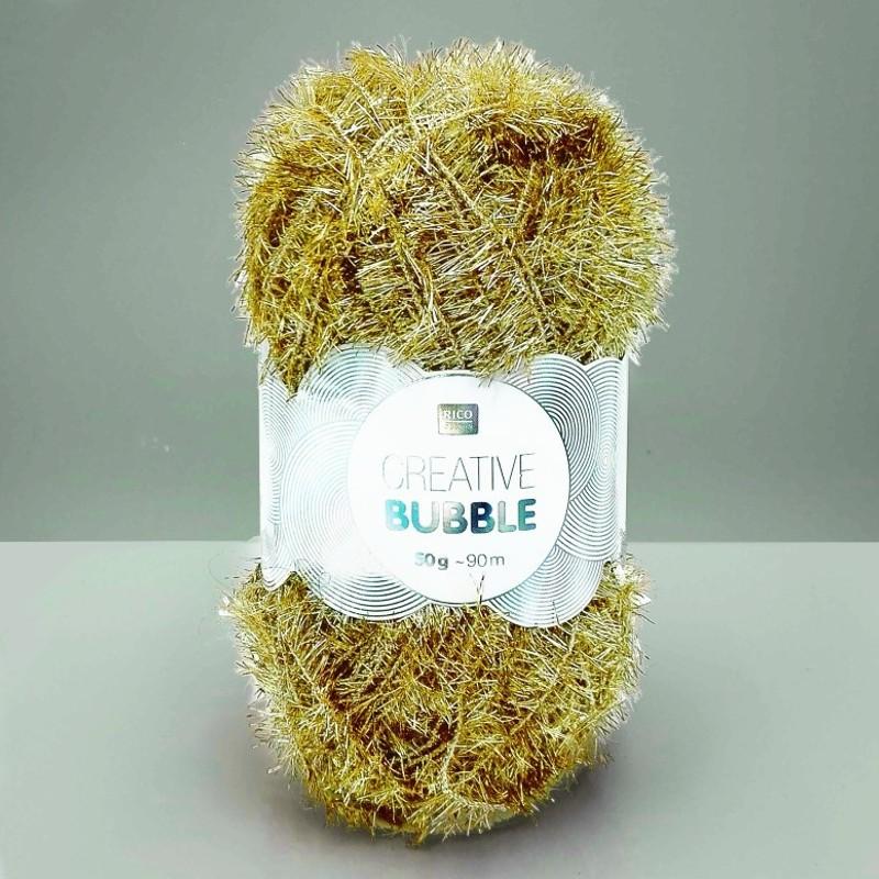 Pelote de laine à crocheter dorée par Rico Design