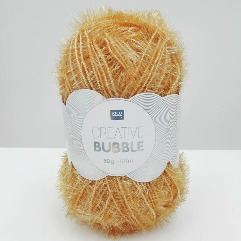 Pelote de laine à crocheter jaune moutarde par Rico Design