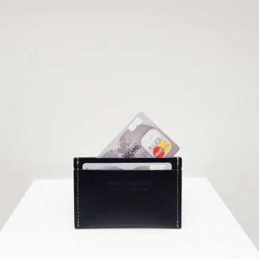 Dos du porte-cartes en cuirs noir et rose fuchsia par Bandit Manchot